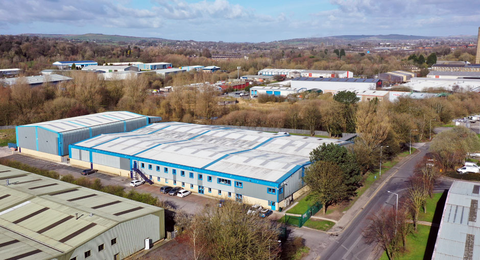 Photo: SGL Co-packing's sites at Nelson, Lancashire, UK.  SGL1 and Head Office is the blue-edged building in the centre, and part of SGL2 is just visible to the bottom right