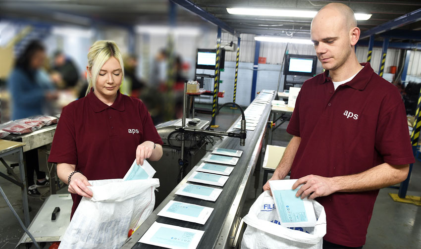 Staff at work inside APS's Blyth, Northumberland, contract packing and fulfilment centre